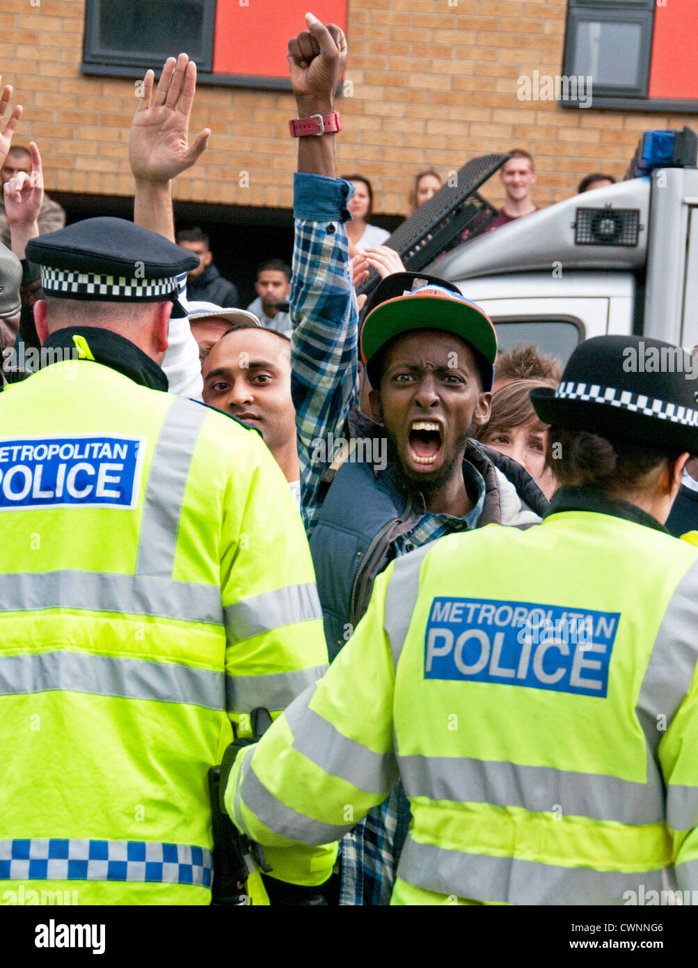Unite Against Fascism and local people from Walthamstow  prevent the racist English Defence League (EDL) marching - Stock Image
