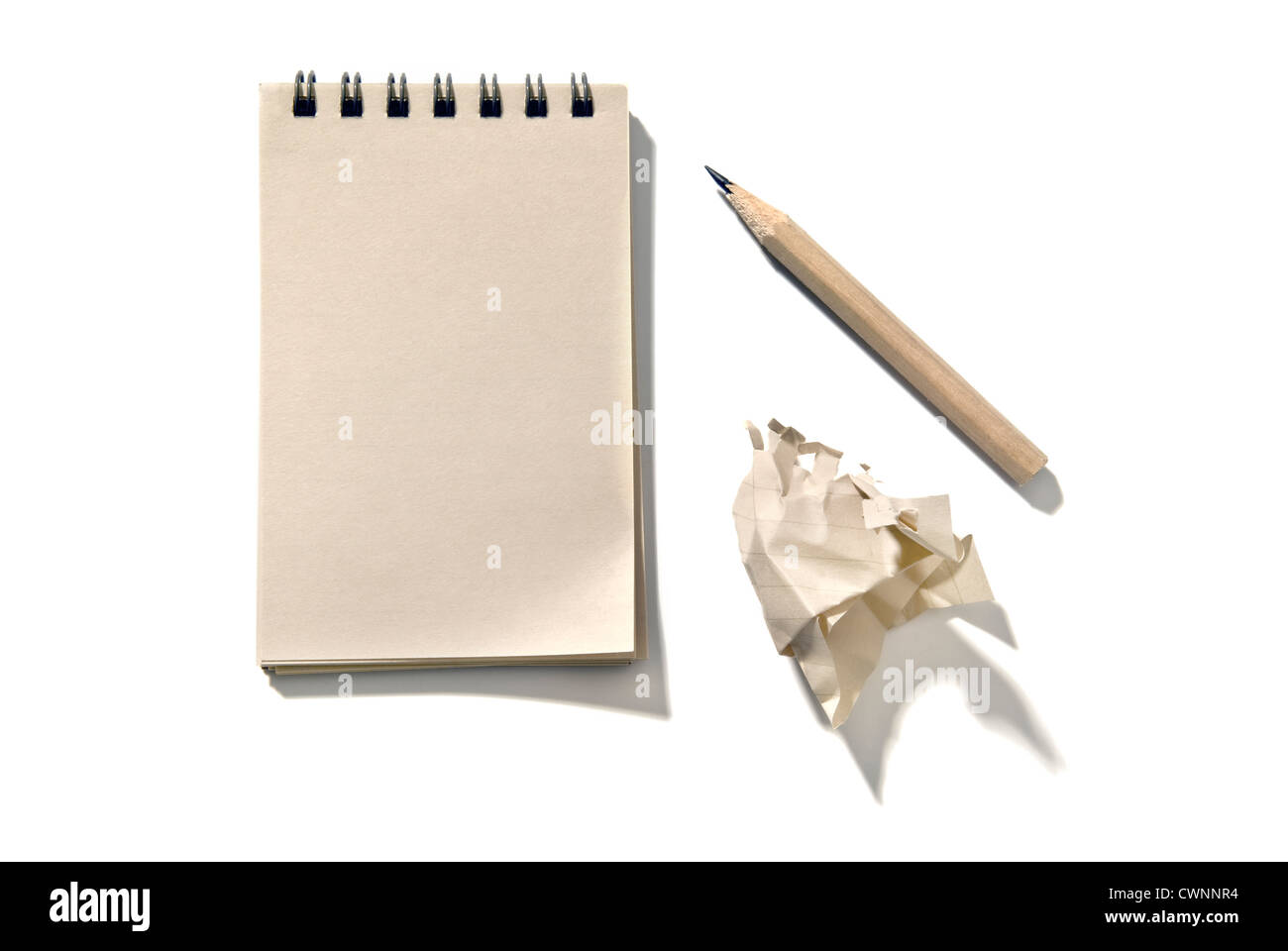 Notepad with a pencil and a piece of crumpled paper, isolated on 100% white background - Stock Image