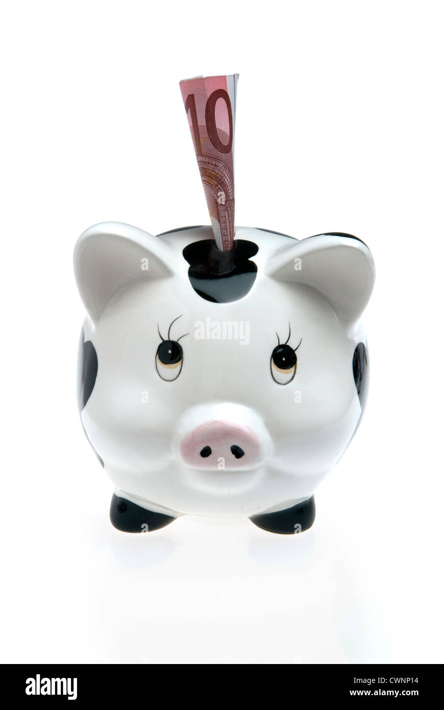 Piggy bank, money box with a ten euro note, isolated on white background - Stock Image