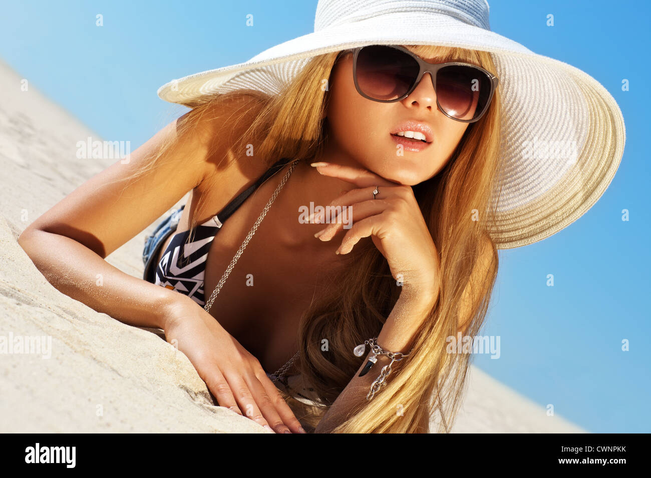 Young slim woman on beach portrait. - Stock Image