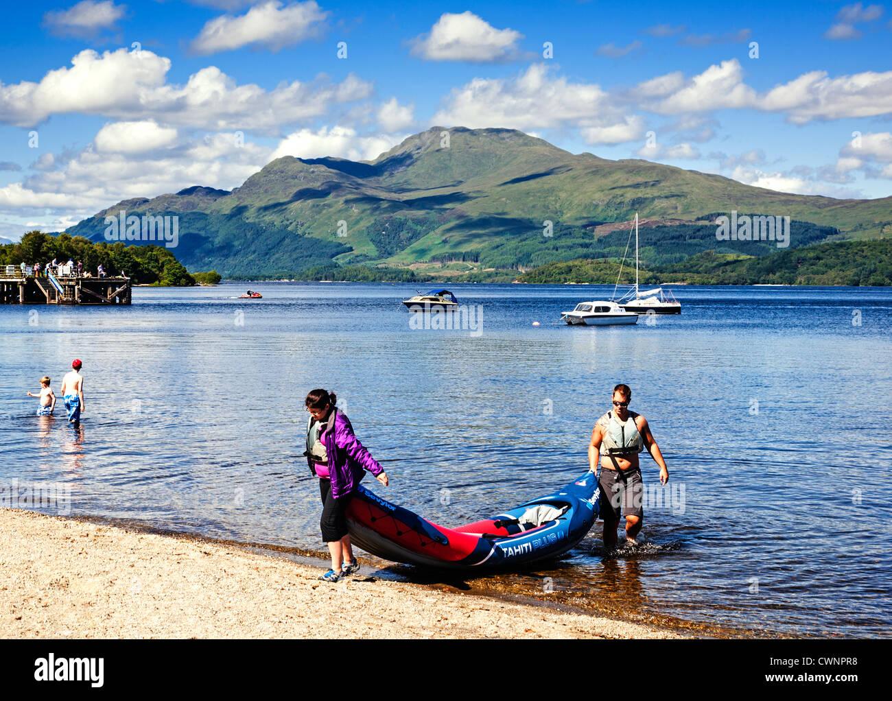 Luss beach in summer, Loch Lomond, Scotland. - Stock Image