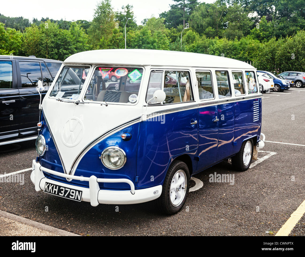 e04625a2545ca0 An old classic blue and white Volkswagen Kombi camper van. - Stock Image