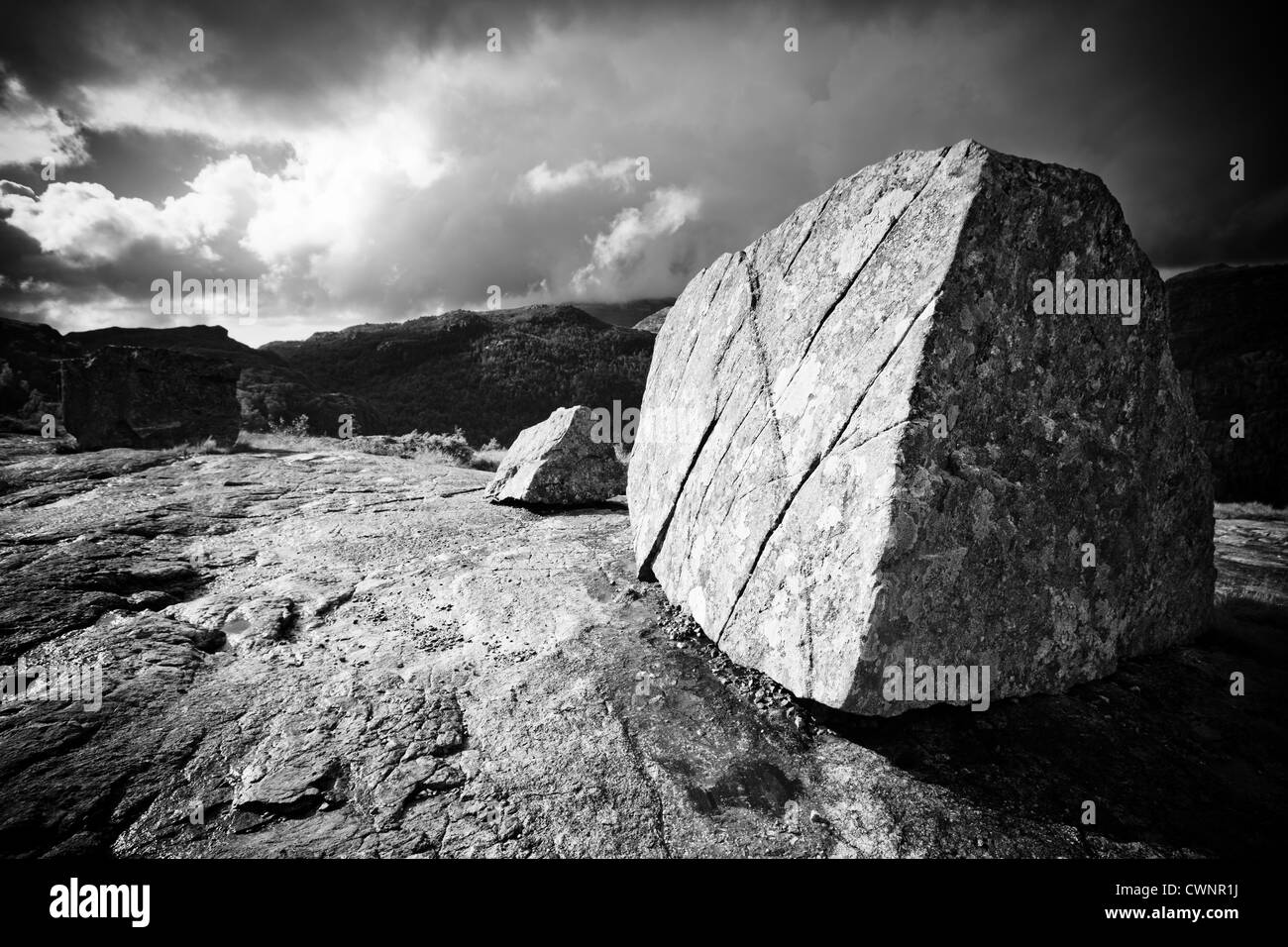 Big stone on mountain top in norway black and white