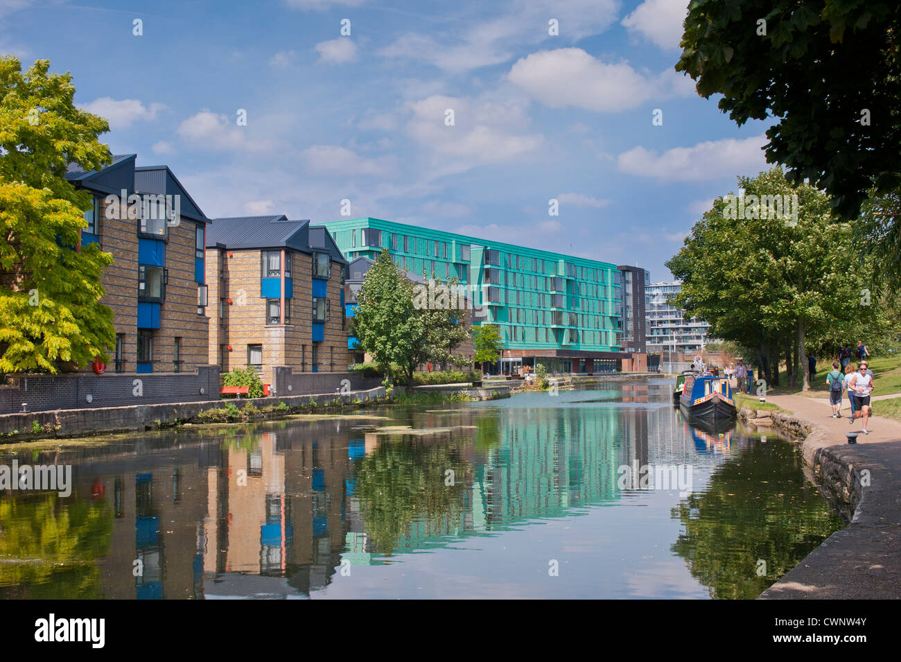 View along the towpath of the Regent's Canal near Mile End in London - Stock Image