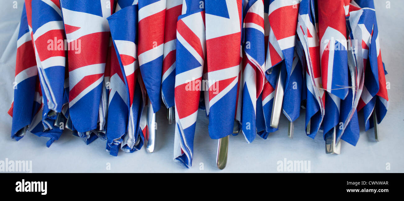 Union Jack flags on napkins as patriotic gesture for jubilee street party celebrations in the UK - Stock Image