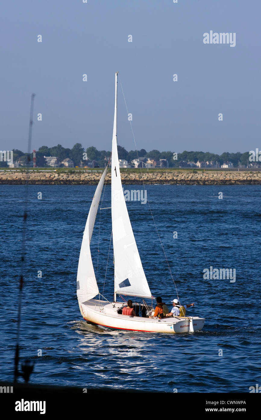Learning how to sail in a small sailboat in Boston Harbor, Boston Massachusetts - Stock Image