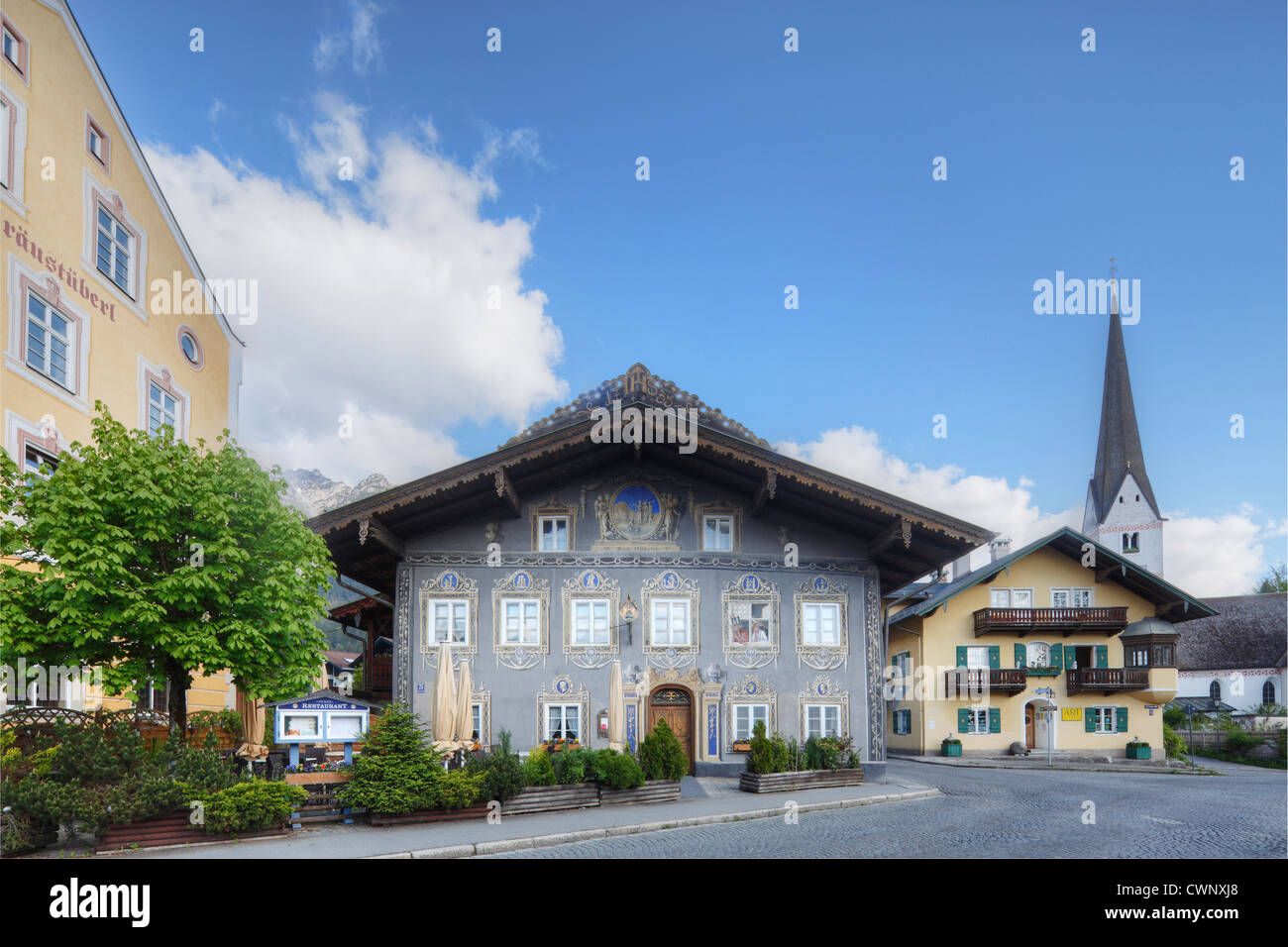 Germany, Bavaria, Garmisch-Partenkirchen, View of parish church and Husar Inn - Stock Image