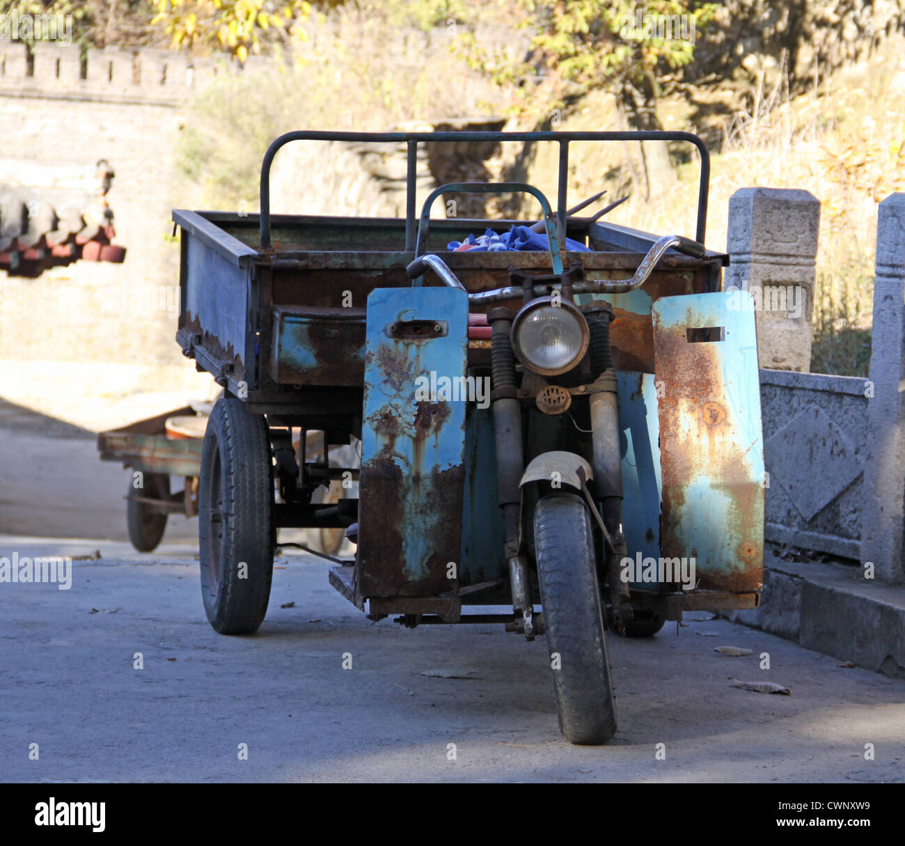 China. Great Wall of China -  site Mutianyu. Motorcycle in the parking - Stock Image