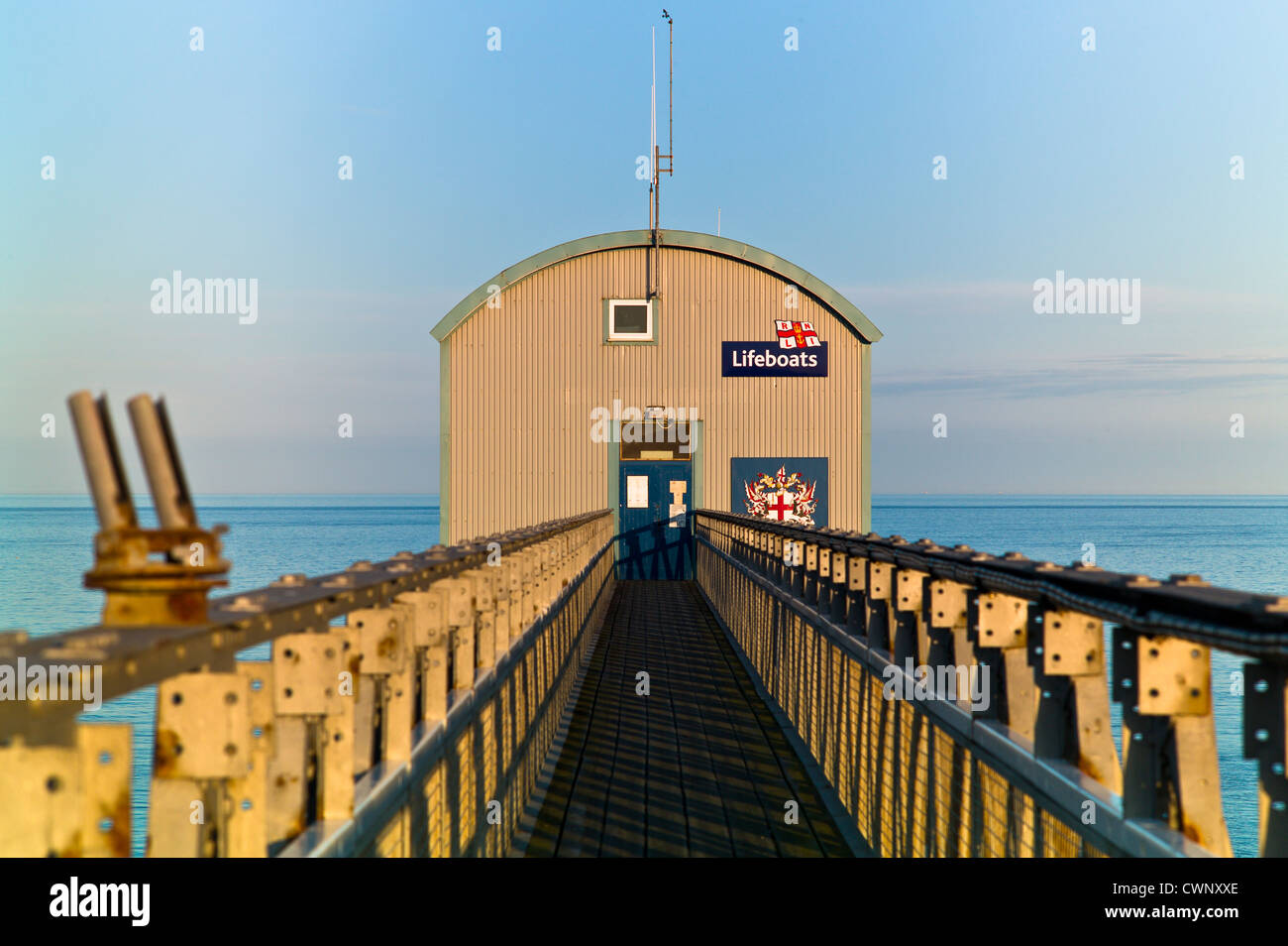 Selsey Lifeboat station seen from gangway with maroon, rocket launchers, on the left - Stock Image