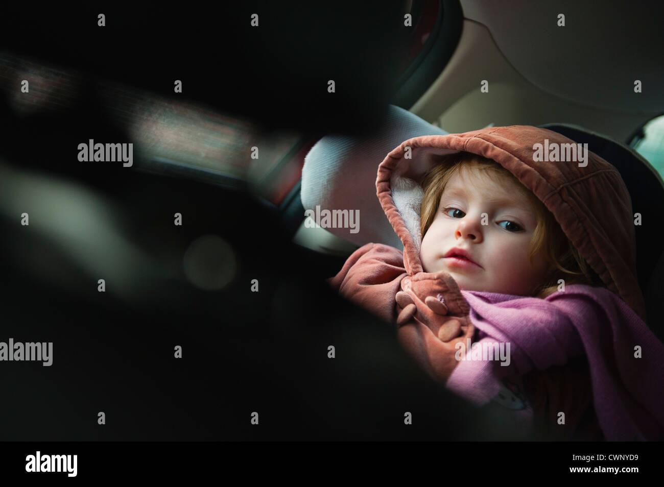 Little girl in car seat, portrait - Stock Image