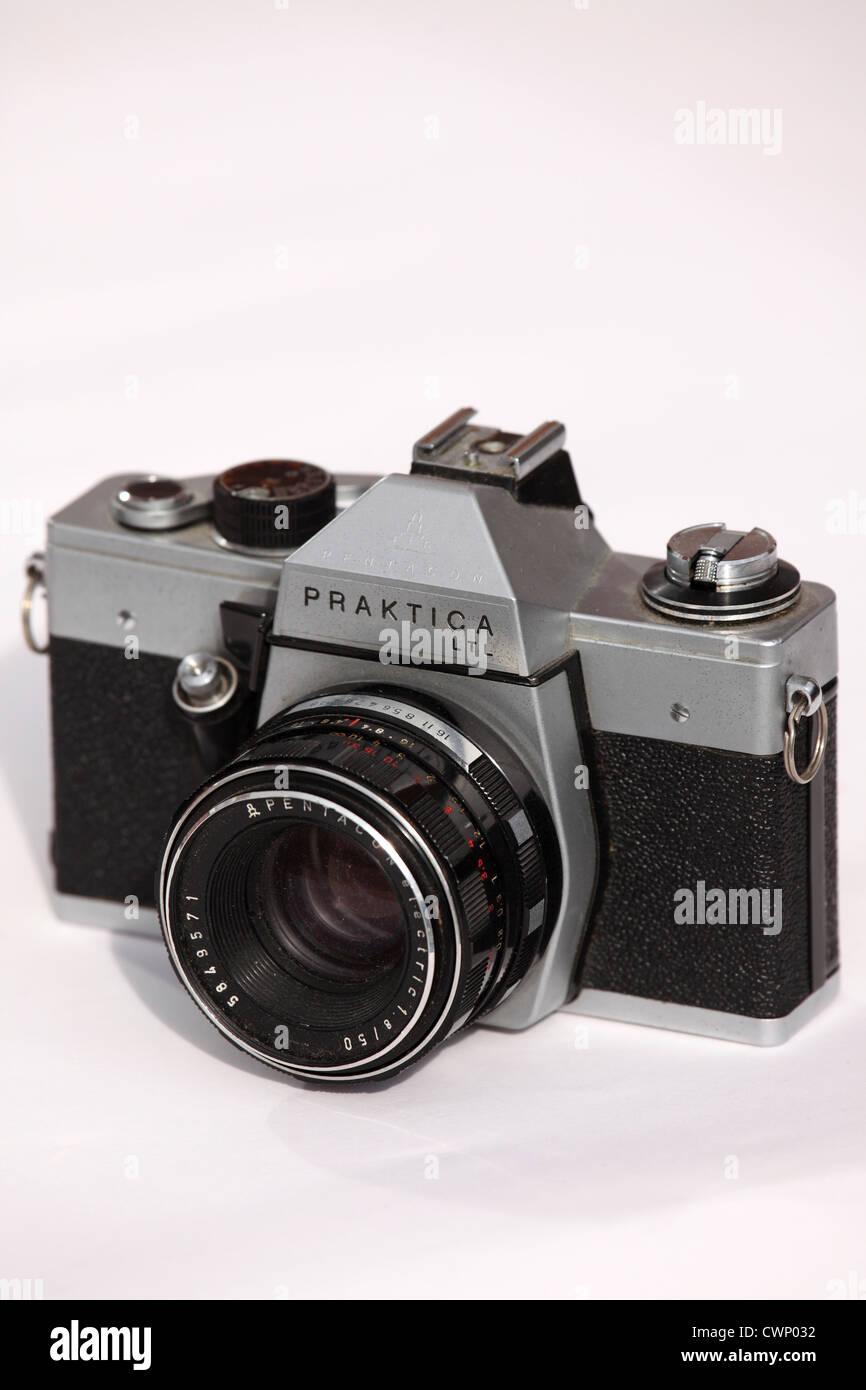 A Praktica 35mm format film camera with a 50mm lens. - Stock Image