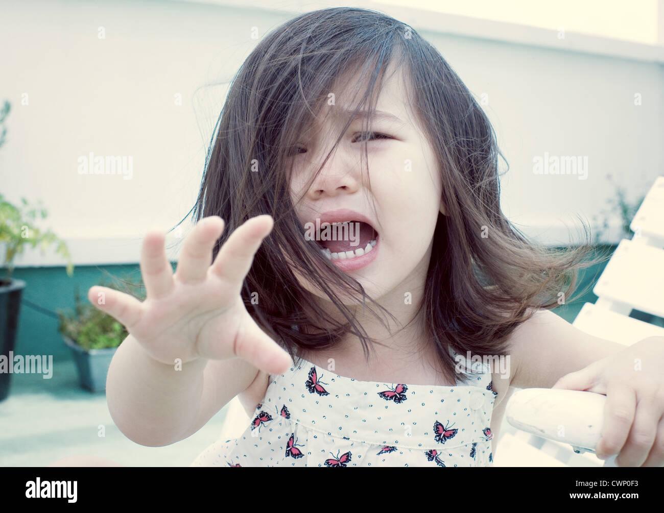 Little girl crying, portrait - Stock Image