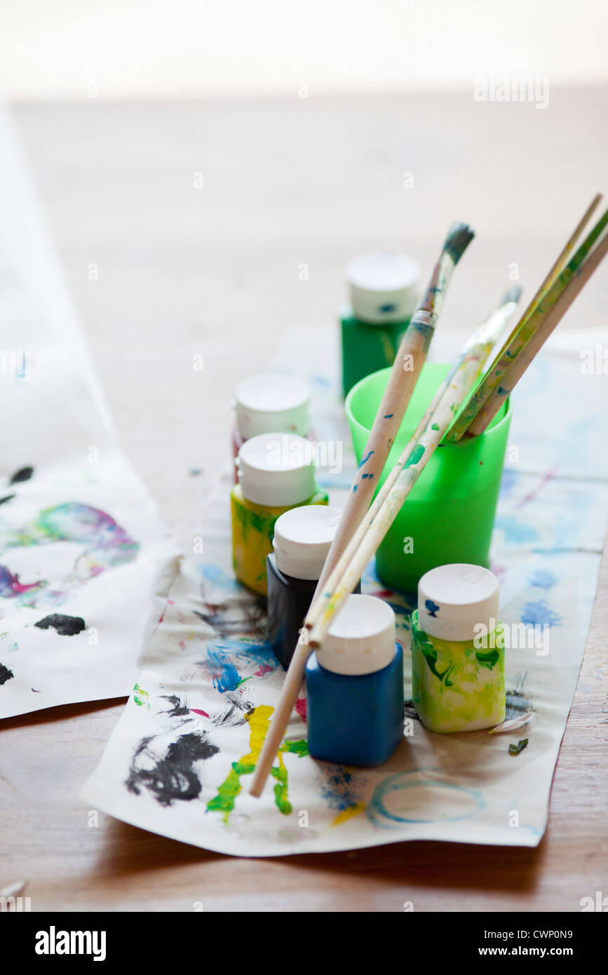 Paint and paintbrushes - Stock Image