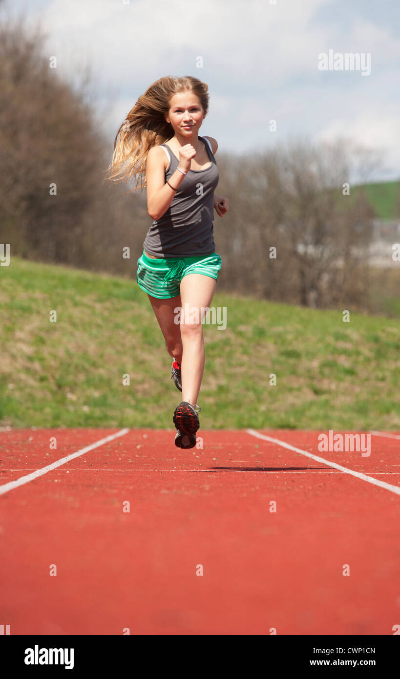 girls running on grass track stock photos girls running on grass