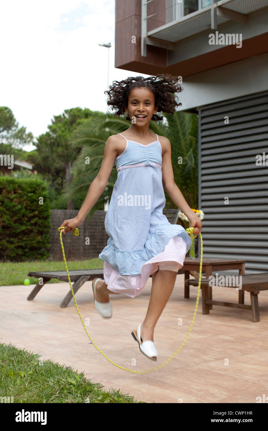 Girl jumping rope - Stock Image