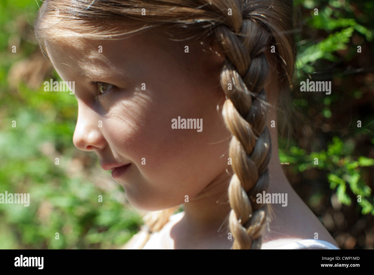 Little girl with braids, profile Stock Photo