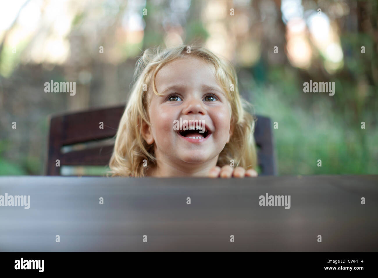 Little girl laughing - Stock Image