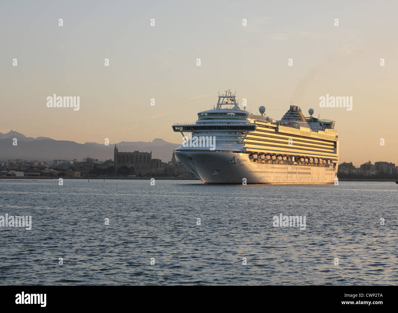 Cunard Line Cruise Ship 'Azura' arriving at early morning into the Port of Palma de Mallorca - with Palma - Stock Image