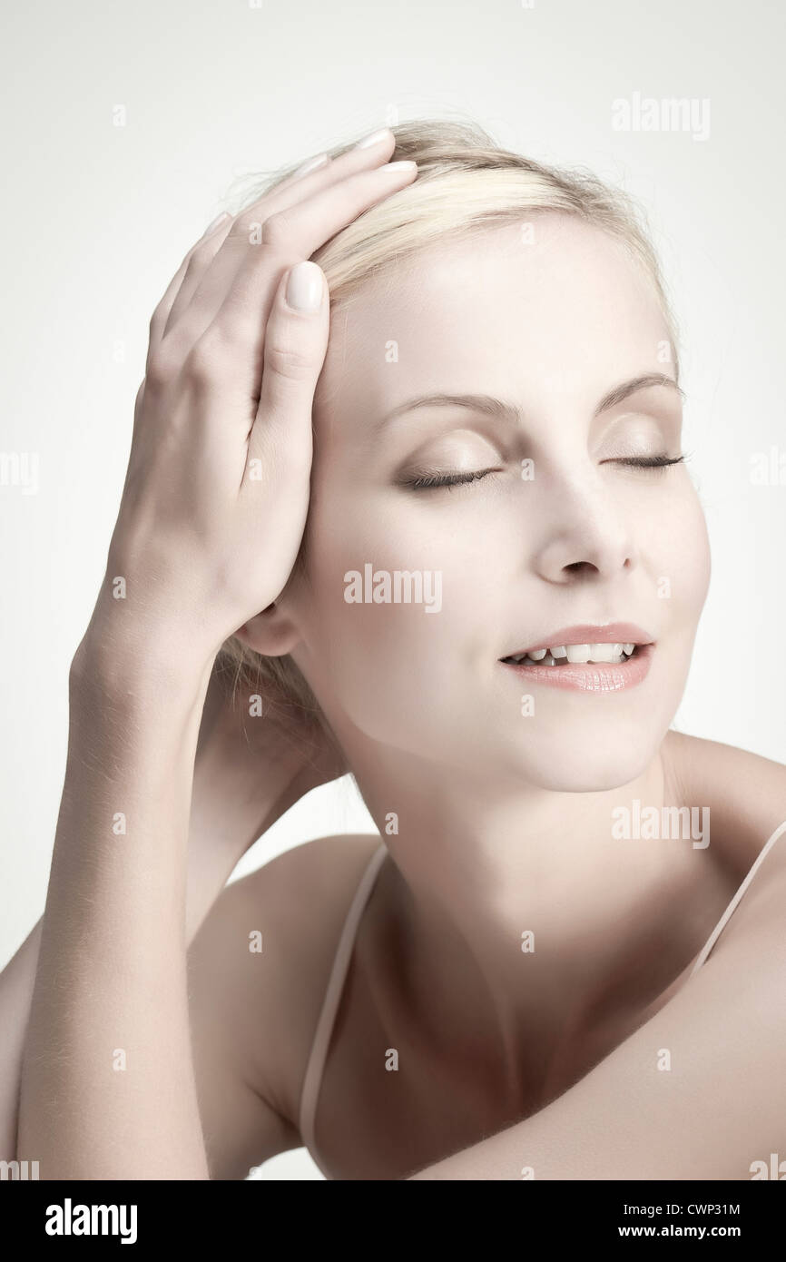 Young woman with eyes closed, portrait - Stock Image
