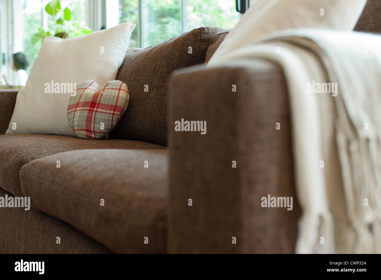 Cushions on sofa in living room - Stock Image