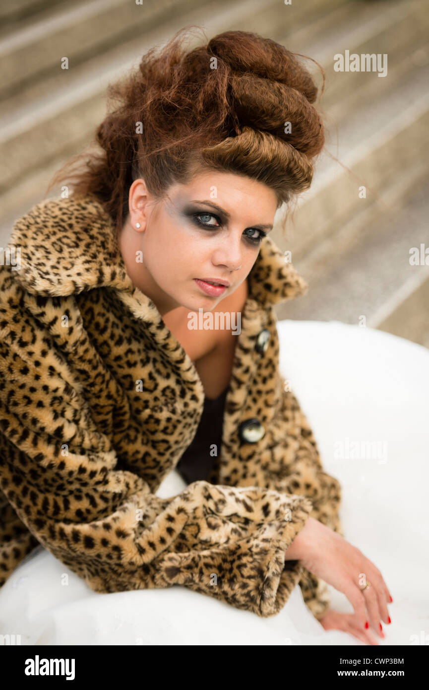 0c5c65a581 a young attractive woman wearing leopard print jacket in an Alt alternative  bride fashion shoot