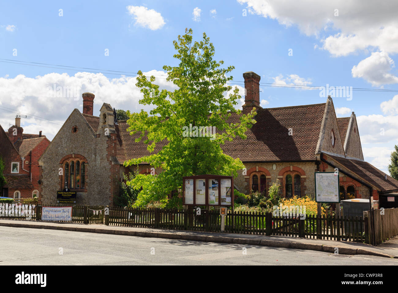 Traditional old Church of England Primary School building in most haunted English village of Pluckley Kent England - Stock Image