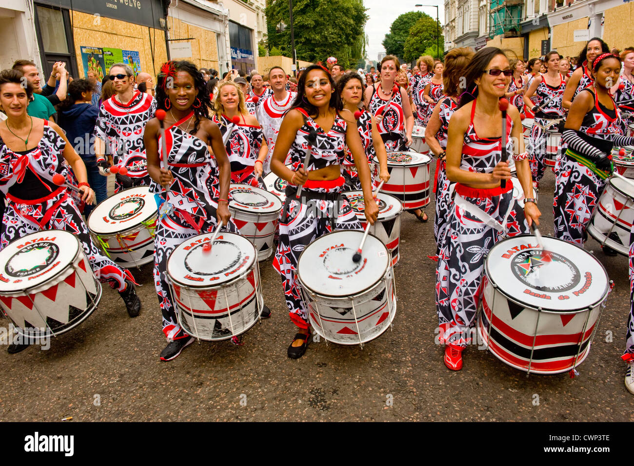 Batala a type of Brazilian drumming - band members drawn from 25 nations The Notting Hill Carnival 2012 - Stock Image