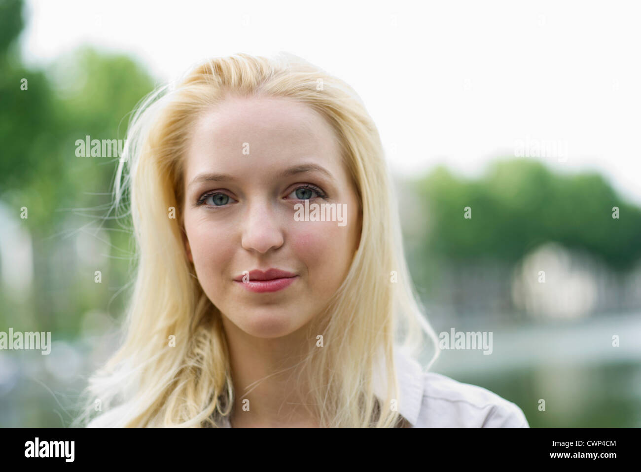Young woman outdoors, portrait - Stock Image