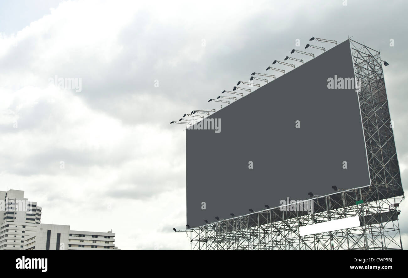 gray empty billboard on city. - Stock Image