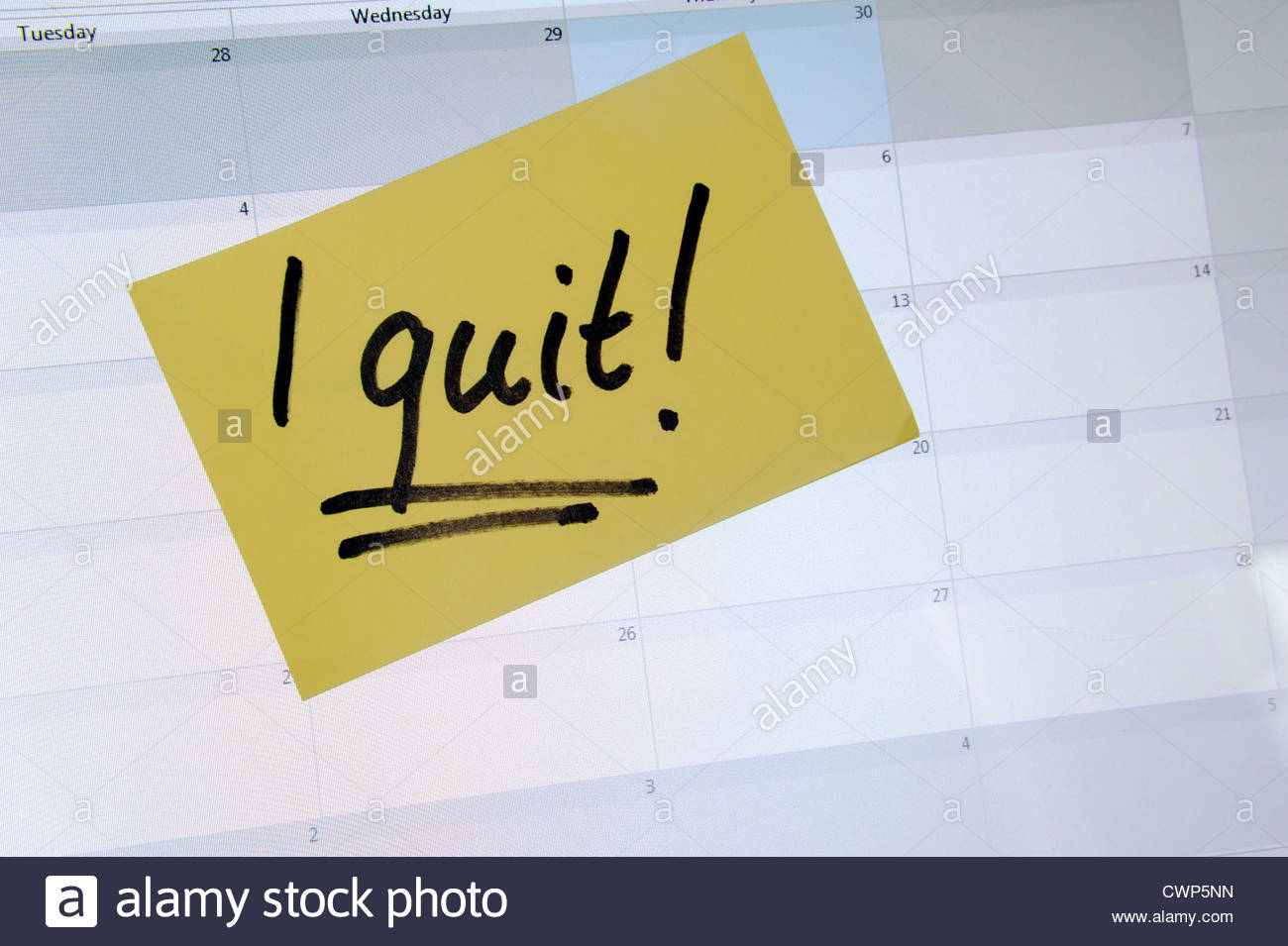Post it note on a laptop computer agenda - I quit! - Stock Image