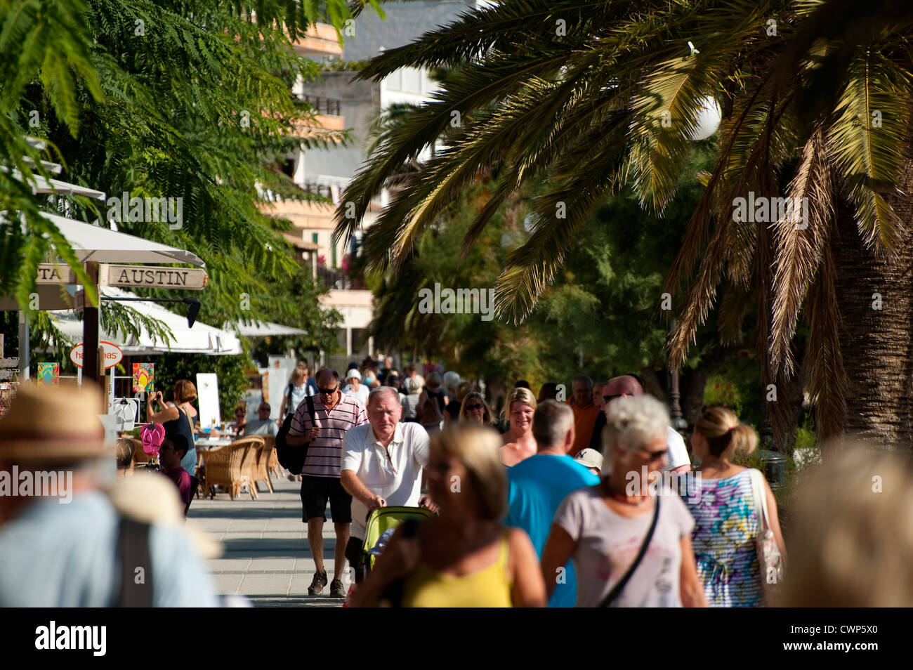 Holidaymakers visiting the popular holiday resort of Puerto de Alcudia, Mallorca, Spain - Stock Image