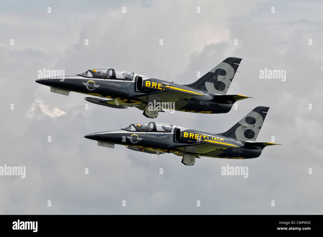A pairs take off from 2x Aero L39 Albatross aircraft of the Breitling jet team - Stock Image