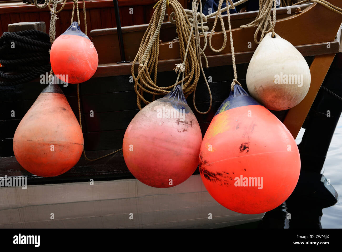 Mooring buoys on the side of a traditional wooden tall ship - Stock Image