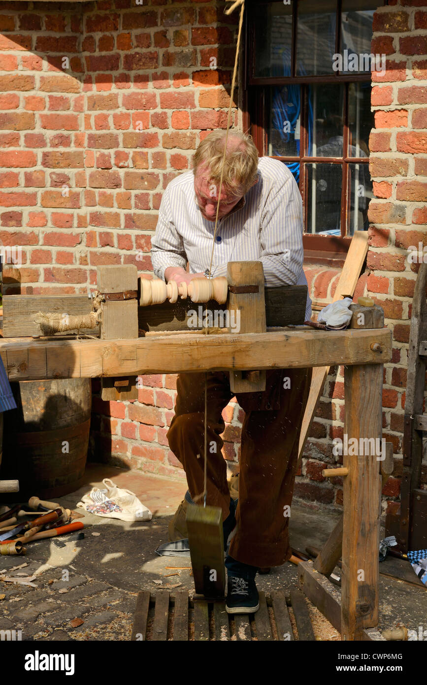 A demonstration of a traditional method of wood turning using a foot operated lathe. - Stock Image
