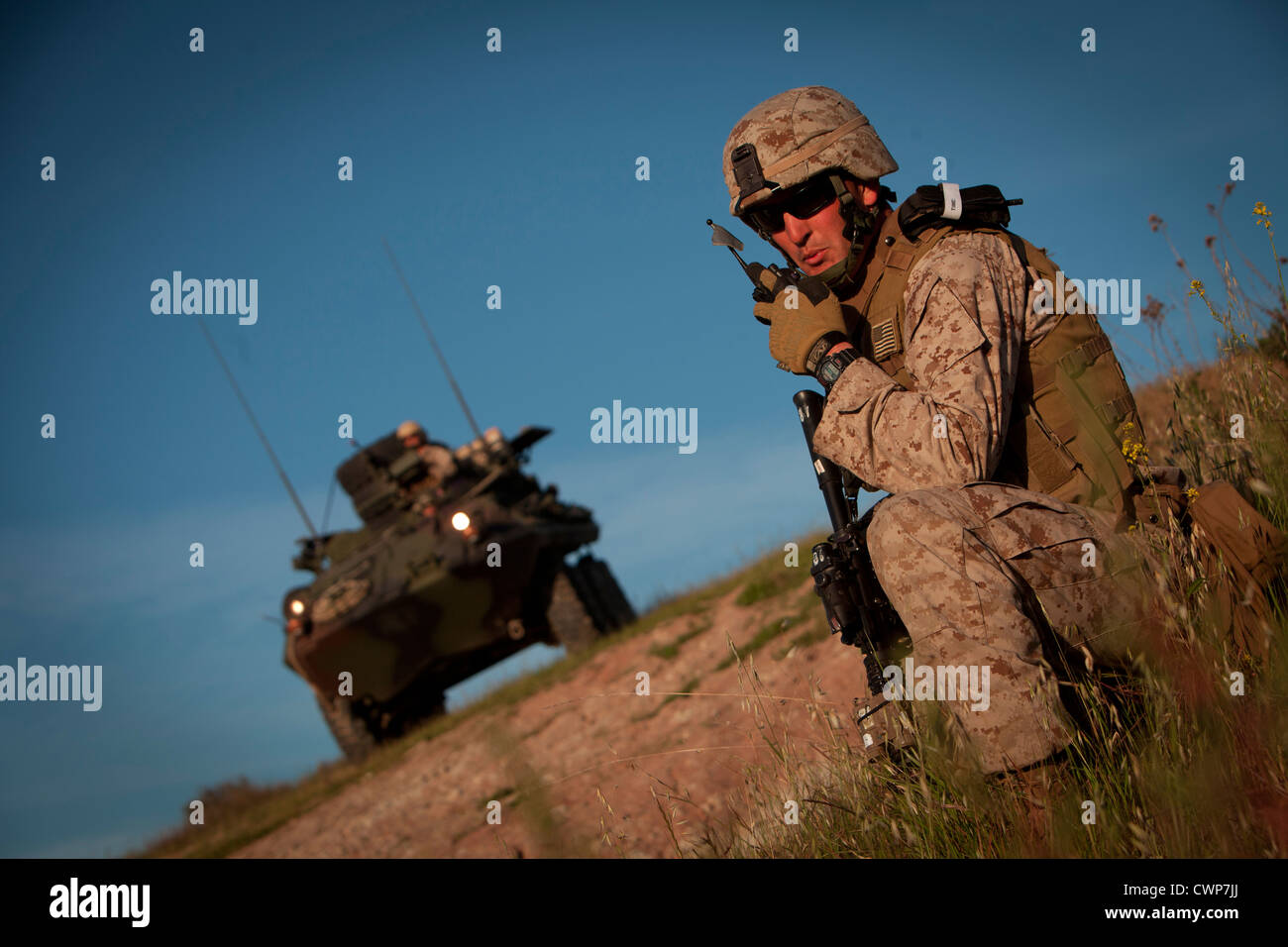 A US Marine relays a status update to his platoon commander during a simulated tactical recovery of personnel scenario - Stock Image