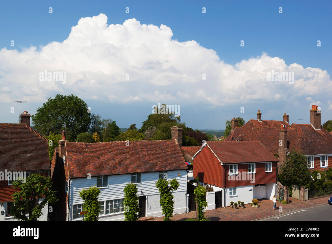 Approaching thunder clouds over Burwash village - Stock Image