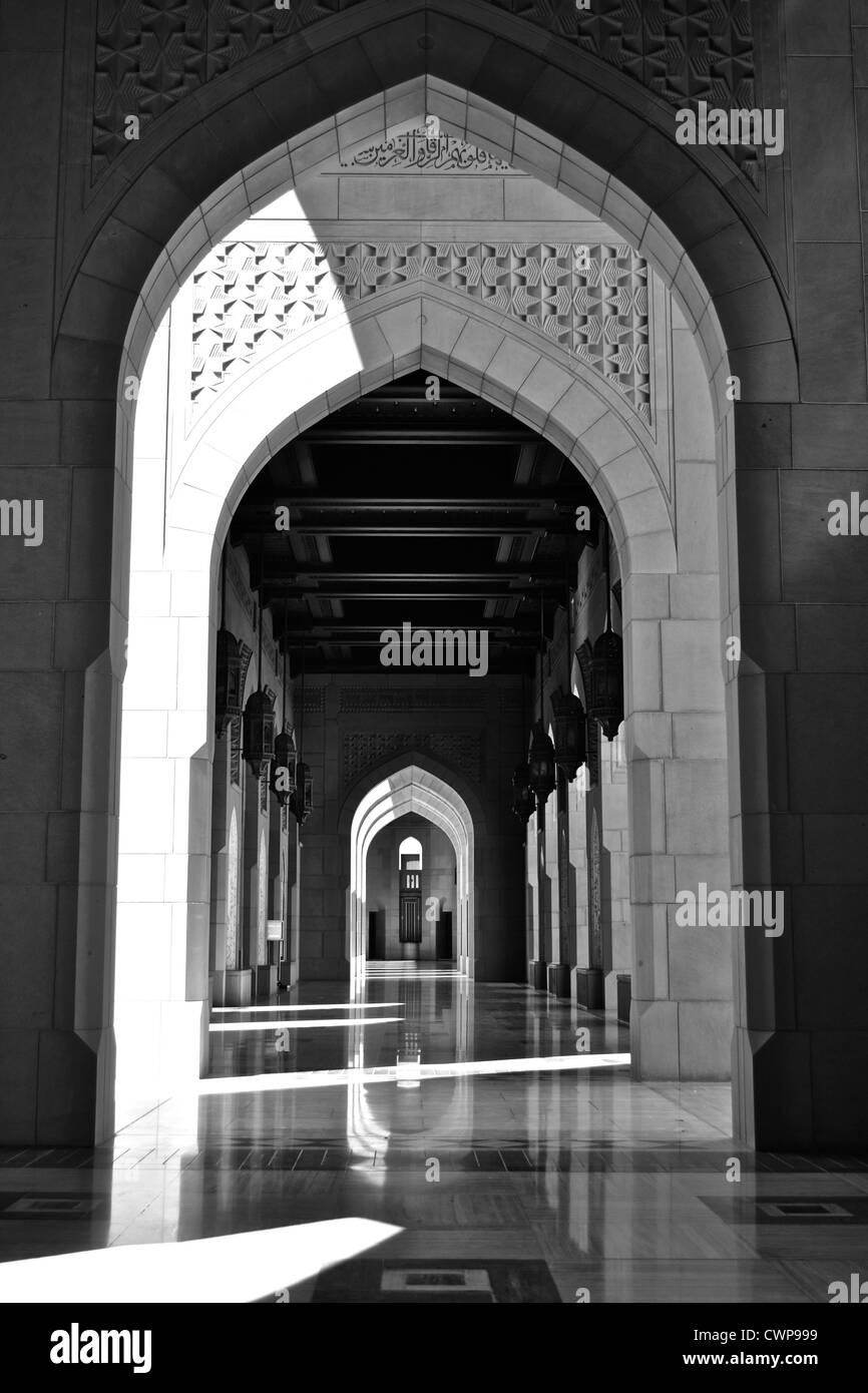 Arcades of the Sultan Qaboos Big Mosque, Muscat, Oman - Stock Image