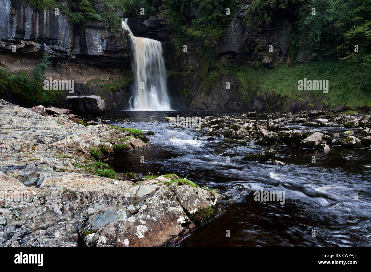 Cascading water at Thornton Force, Ingleton, North Yorkshire - Stock Image