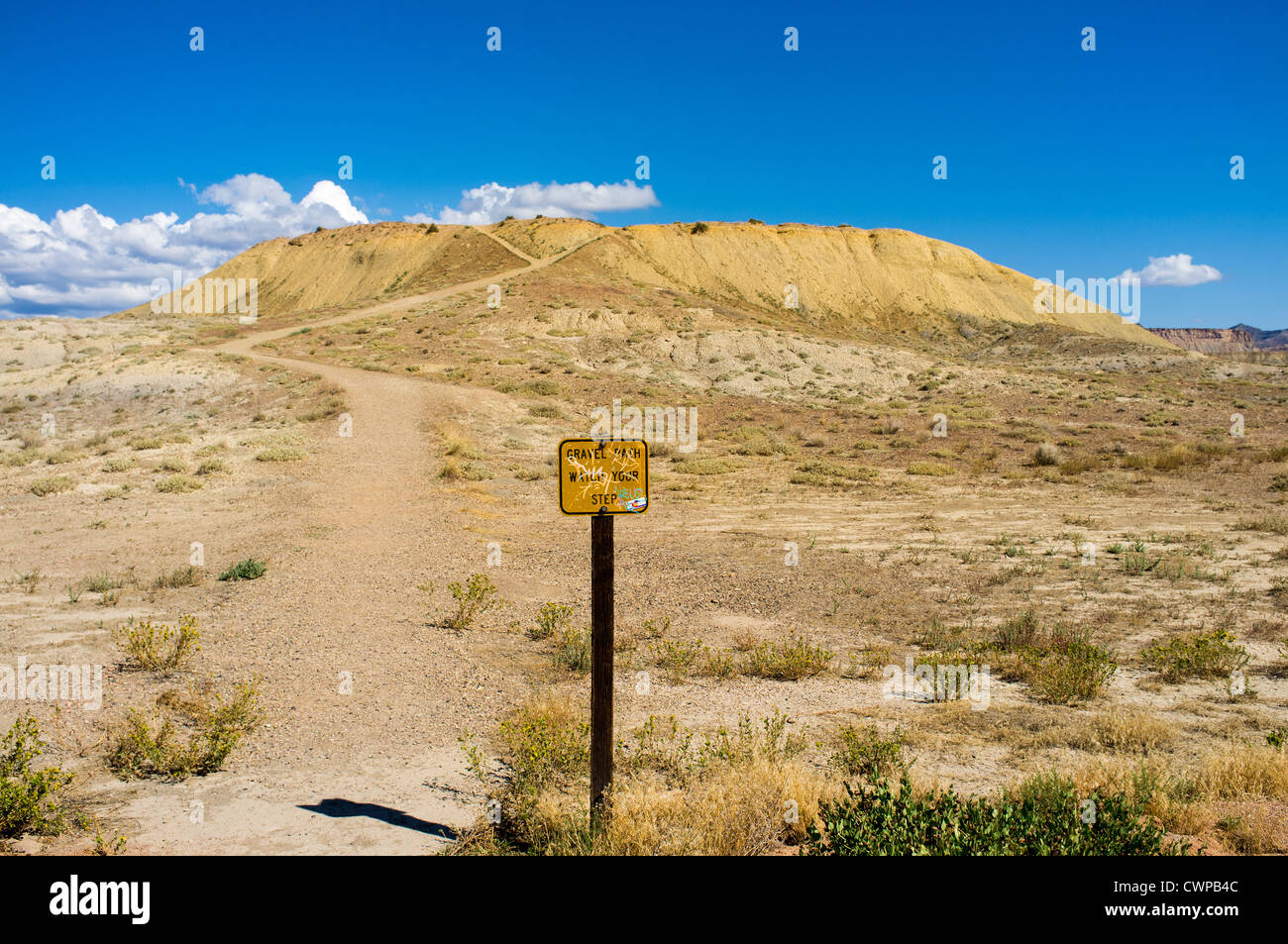 A hiking trail leads off into the desert. - Stock Image