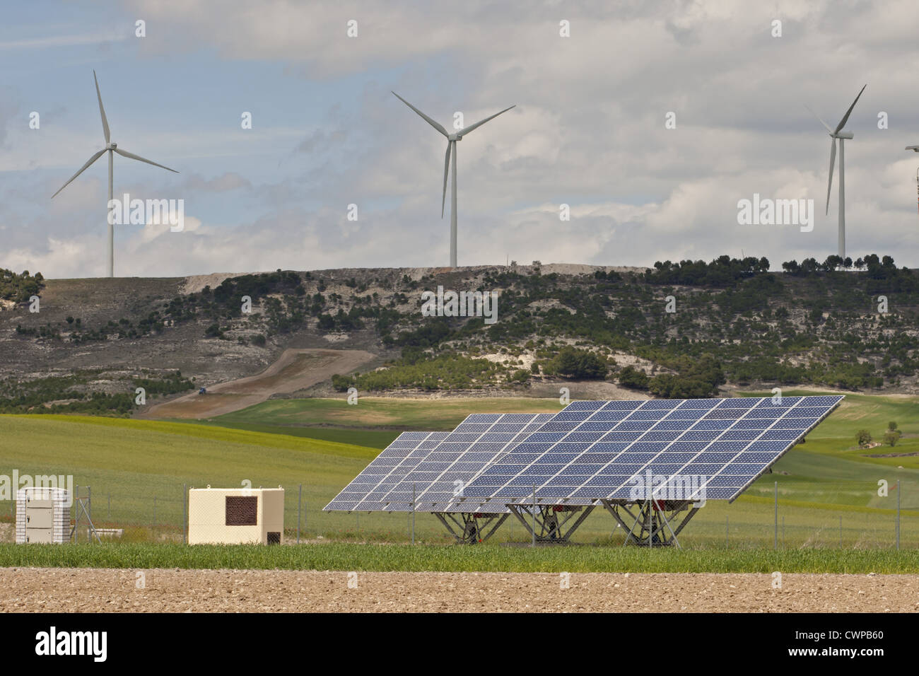 Solar energy panels and wind turbines on open plains, Castilla y Leon, Spain, may - Stock Image