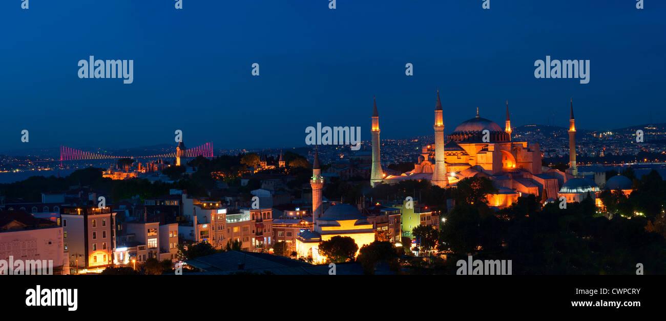 Panorama over Hagia Sophia museum and Bosphorus bridge at night, Istanbul, Turkey Stock Photo