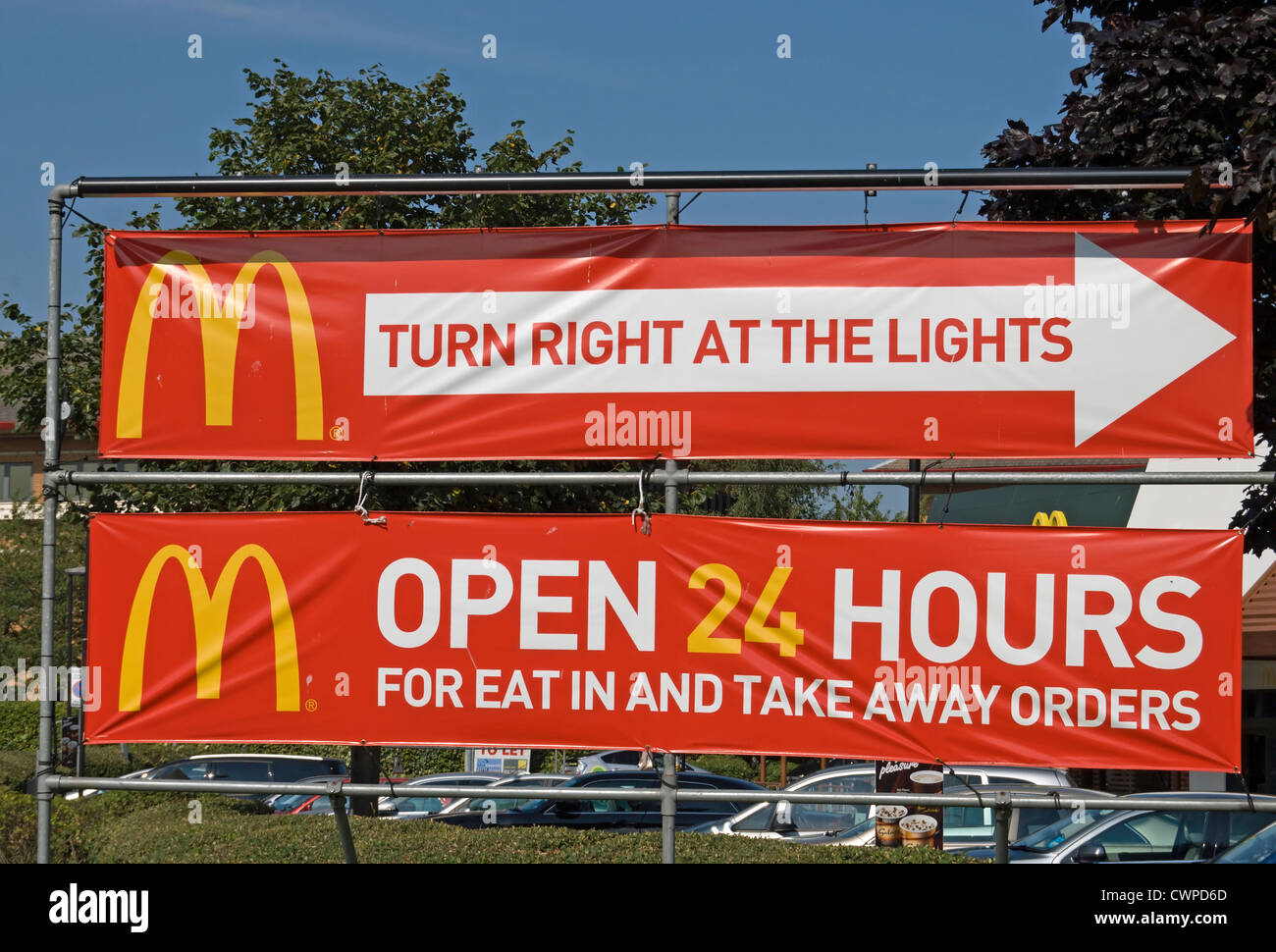 Banner Signs For A 24 Hour Branch Of Mcdonalds Fast Food Restaurant