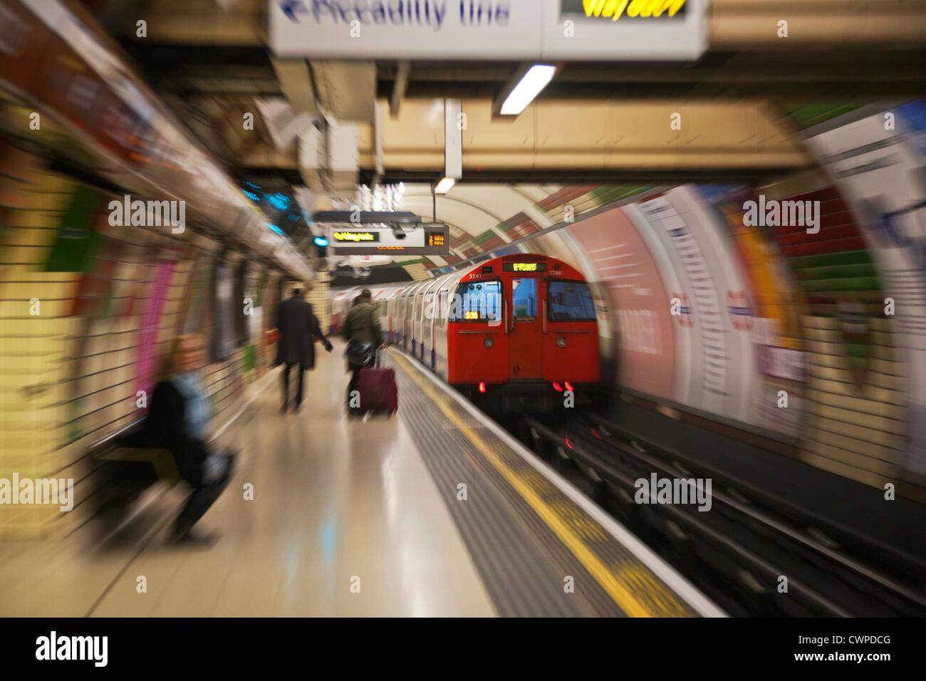 UK. England. London. Tube train arriving at platform of Underground Station. - Stock Image
