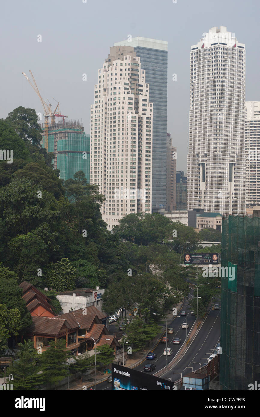 The old heritage bungalows and the new world in the backdrop in KL ( Kaula Lumpur ) capital city of Malaysia - Stock Image