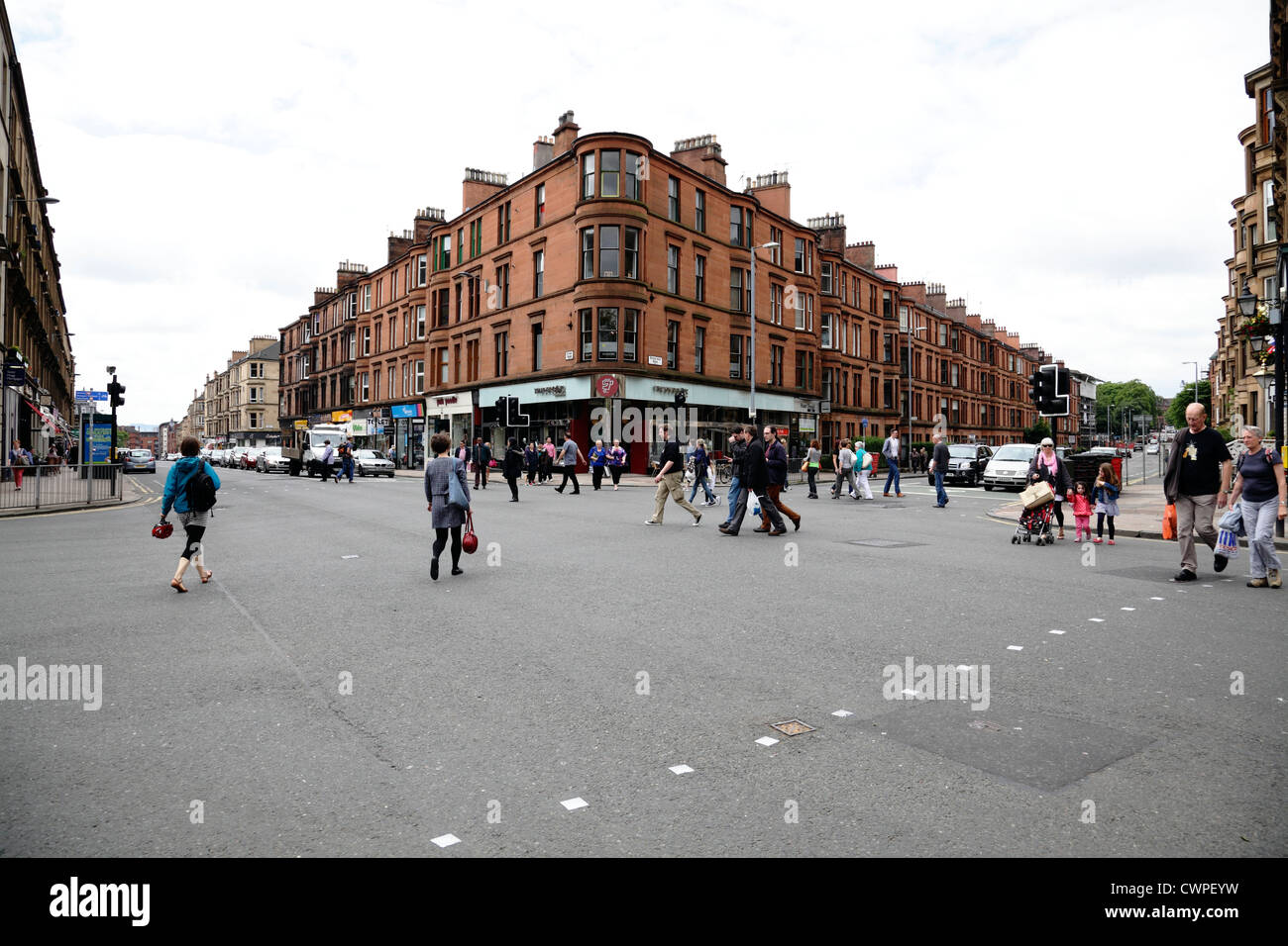 Pedestrians crossing Byres Road in the West End of Glasgow, Scotland, UK - Stock Image