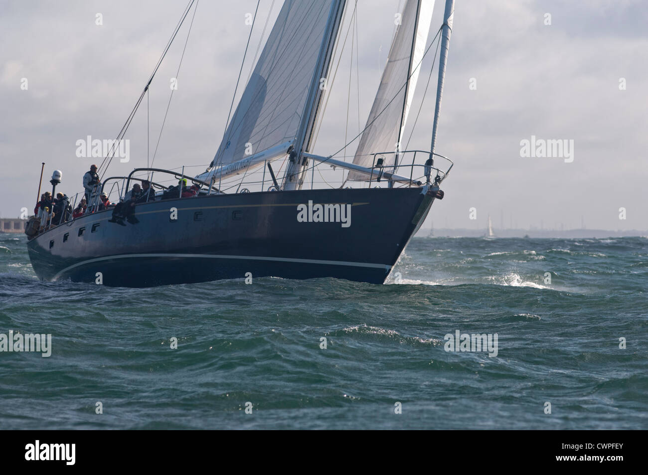 Sailing yachts competing in the JP Morgan Round the Island race in 2012 passed the Needles Stock Photo
