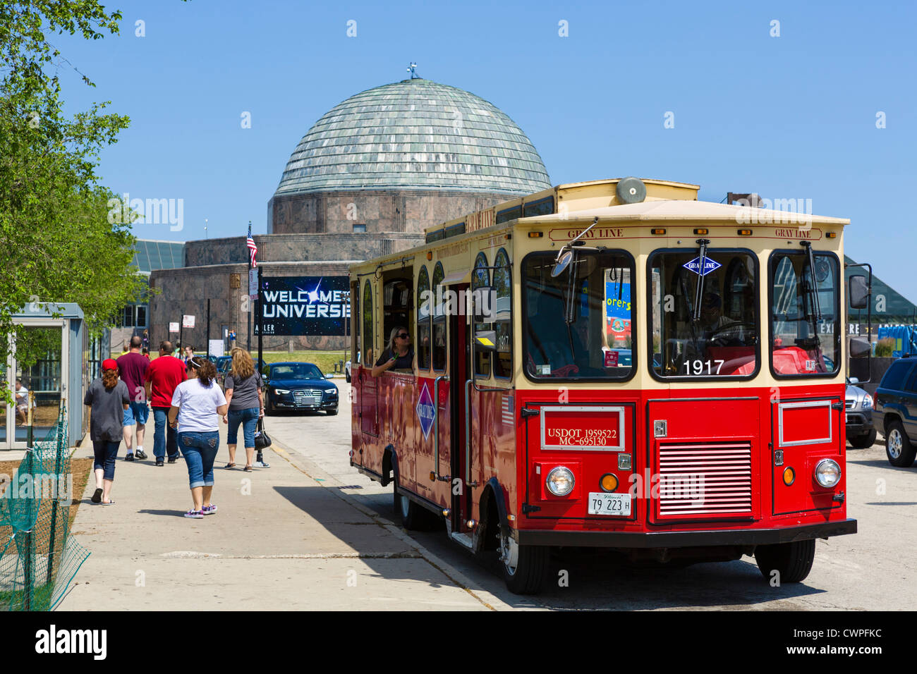 Gray Line trolley tour in front of the Adler Planetarium on the Museum Campus in Grant Park, Chicago, Illinois, - Stock Image