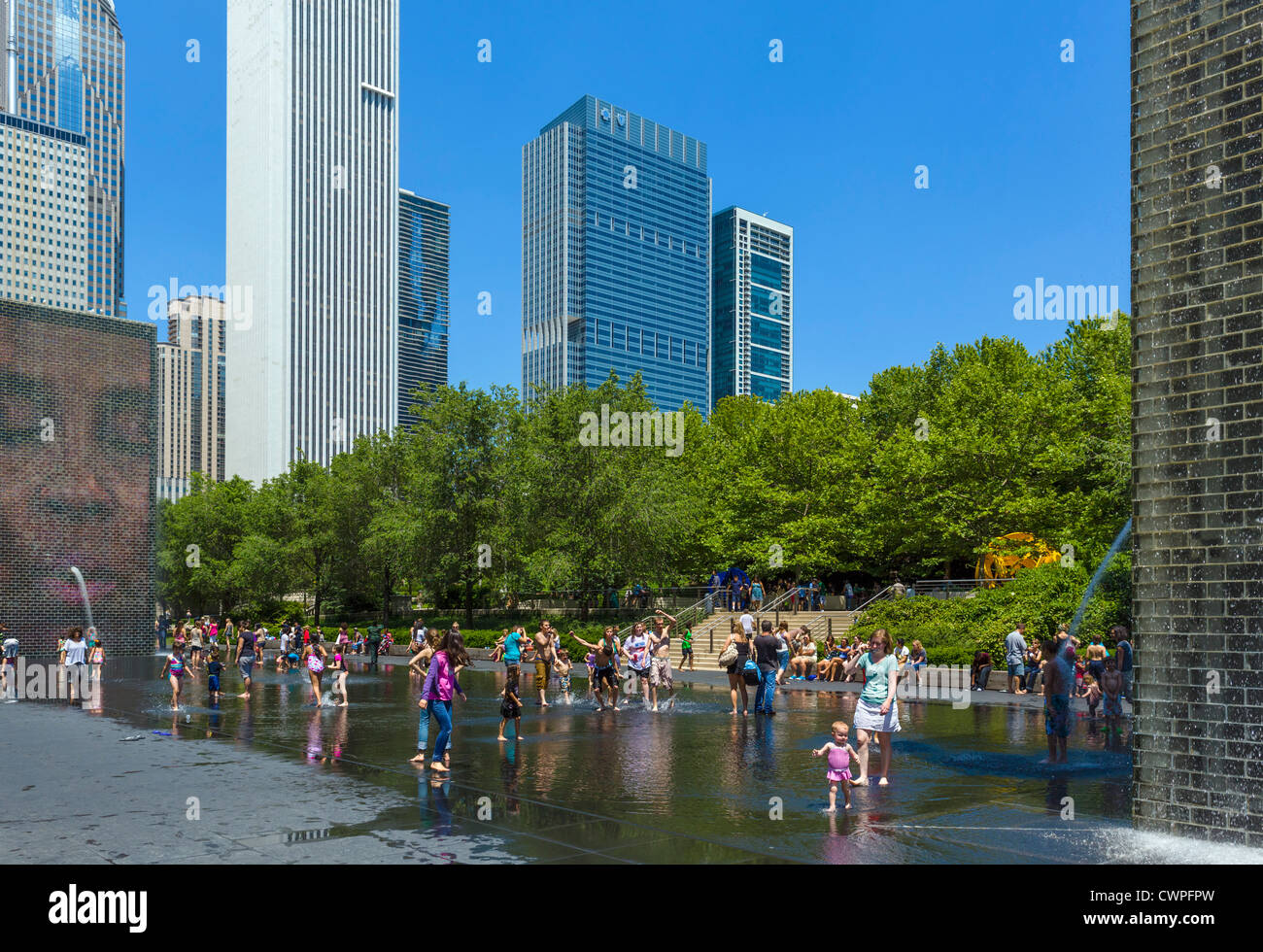 People cooling off in Crown Fountain in Millennium Park during an early summer heatwave, Chicago, Illinois - Stock Image