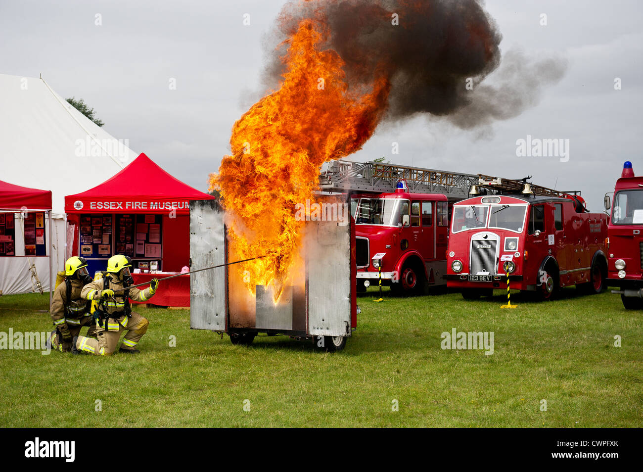 Essex County Fire and Rescue Service - A demonstration by Essex Fire Service of a chip pan fire at the Orsett Show - Stock Image
