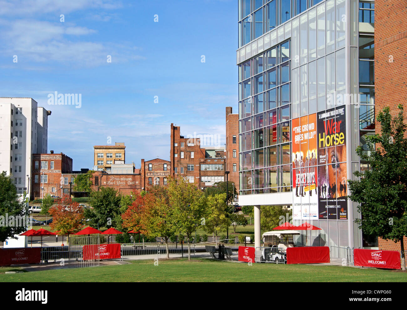 Durham, North Carolina, NC. Durham Performing Arts Center in the foreground overlooking old brick buildings in downtown. - Stock Image